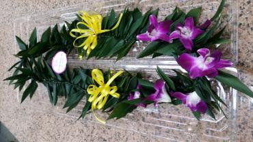 Hawaiian T leaves with orchids and ribbon