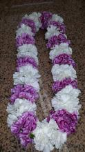 White and purple carnation lei